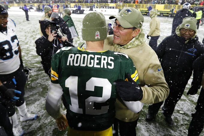 Carolina Panthers head coach Ron Rivera talks to Green Bay Packers' Aaron Rodgers after an NFL football game Sunday, Nov. 10, 2019, in Green Bay, Wis. The Packers won 24-16. (AP Photo/Mike Roemer)