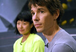 In this June 18, 2019, photo, rock climbers Alex Honnold, right, and Ashima Shiraishi are interviewed at the Earth Treks gym in Englewood, Colo. Honnold is trying to get a grip on life in the aftermath of the Academy Award winning documentary