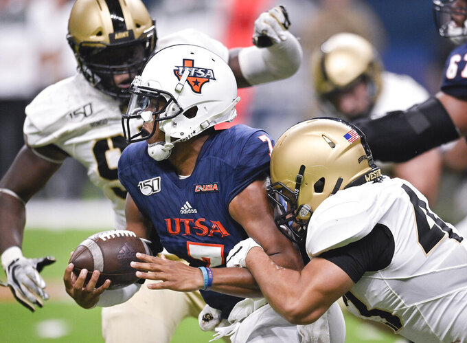 UTSA quarterback Frank Harris is brought down by Army's Jeremiah Lowery, right, during the second half of an NCAA college football game Saturday, Sept. 14, 2019, in San Antonio. (AP Photo/Darren Abate)