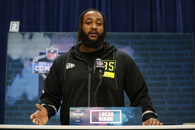 TCU offensive lineman Lucas Niang speaks during a press conference at the NFL football scouting combine in Indianapolis, Wednesday, Feb. 26, 2020. (AP Photo/Michael Conroy)
