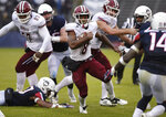 Massachusetts running back Marquis Young (8) breaks a tackle and runs for yardage during the second half of an NCAA college football game against Connecticut, Saturday, Oct. 27, 2018, in East Hartford, Conn. (AP Photo/ (AP Photo/Jessica Hill)