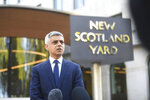 Mayor of London Sadiq Khan speaks to media at New Scotland Yard, following the death of a police officer, in London, Friday, Sept. 25, 2020. A British police officer has been shot dead inside a London police station while detaining a suspect. The attacker then appears to have turned the gun on himself. London's Metropolitan Police force said the officer was shot at the Croydon Custody Center in the south of the city early Friday. The 23-year-old suspect is in a critical condition in a hospital. (Victoria Jones/Pool Photo via AP)