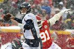 Denver Broncos quarterback Drew Lock (3) looks to throw a pass as Kansas City Chiefs defensive tackle Derrick Nnadi (91) pursues during the second half of an NFL football game in Kansas City, Mo., Sunday, Dec. 15, 2019. (AP Photo/Ed Zurga)