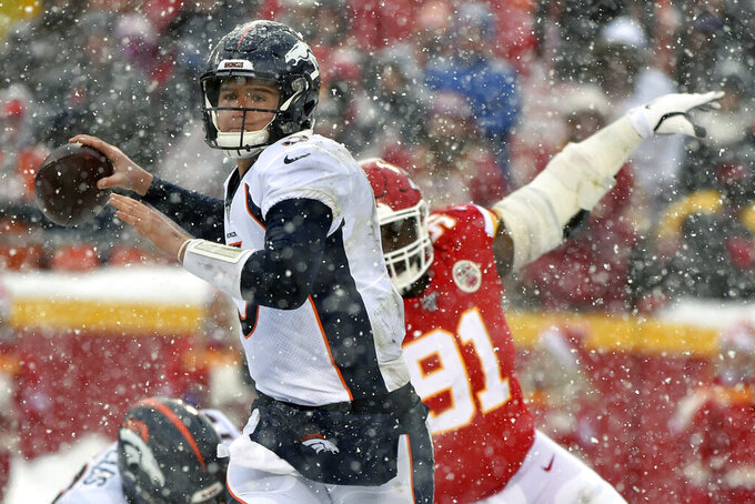 Denver Broncos quarterback Drew Lock (3) looks to throw a pass as Kansas City Chiefs defensive tackle Derrick Nnadi (91) pursues during the second half of an NFL football game in Kansas City, Mo., Sunday, Dec. 15, 2019. (AP Photo/Ed Zurga)
