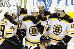 Boston Bruins left wing Taylor Hall (71) laughs with teammates after inadvertently scoring a goal against the New Jersey Devils during the second period of an NHL hockey game, Tuesday, May 4, 2021, in Newark, N.J. (AP Photo/Kathy Willens)