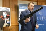 James Swartz, director of World Against Toys Causing Harm, holds a realistic toy machine gun during a news conference unveiling the organization's list of worst toys for the holidays, Tuesday, Nov. 19, 2019, in Boston. (AP Photo/Michael Dwyer)