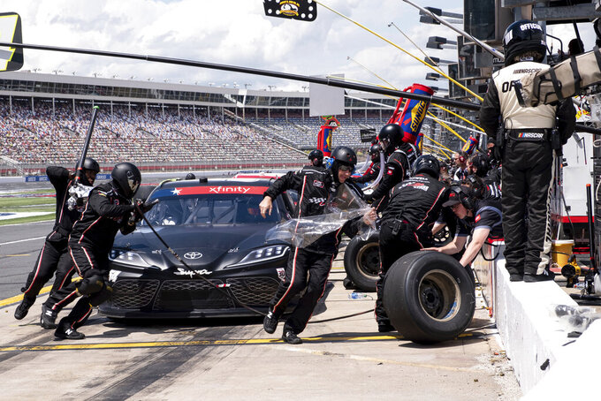 The pit crew works on Ty Gibbs' car during a NASCAR Xfinity Series auto race at Charlotte Motor Speedway, Saturday, May 29, 2021, in Charlotte, N.C. (AP Photo/Ben Gray)