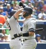 New York Yankees' Gary Sanchez celebrates with teammate Gio Urshela after hitting a home run during the fourth inning of a baseball game against the Toronto Blue Jays, Saturday, Aug. 10, 2019 in Toronto. (Fred Thornhill/The Canadian Press)