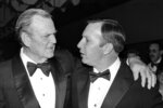 "FILE - In this March 8, 1982, file photo, Alabama University football coach Paul ""Bear"" Bryant, left, talks with Auburn University football coach Pat Dye during a reception in Washington. Former Auburn coach Pat Dye, who took over a downtrodden football program in 1981 and turned it into a Southeastern Conference power, has died. He was 80. Lee County Coroner Bill Harris said Dye passed away Monday, June 1, 2020, at the Compassus Bethany House in Auburn, Ala. (AP Photo/Dennis Cook, File)"