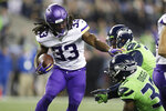 Minnesota Vikings' Dalvin Cook (33) carries against the Seattle Seahawks during the first half of an NFL football game, Monday, Dec. 2, 2019, in Seattle. (AP Photo/John Froschauer)