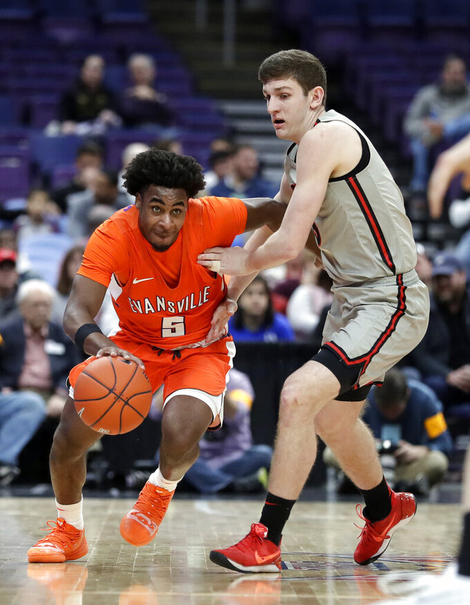 Evansville's Shamar Givance, left, brings the ball up past Illinois State's Matt Hein during the first half of an NCAA college basketball game in the first round of the Missouri Valley Conference men's tournament Thursday, March 7, 2019, in St. Louis. (AP Photo/Jeff Roberson)