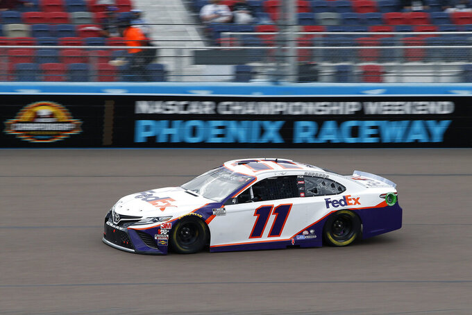 Denny Hamlin (11) races through Turn 4 during the NASCAR Cup Series auto race at Phoenix Raceway, Sunday, Nov. 8, 2020, in Avondale, Ariz. (AP Photo/Ralph Freso)