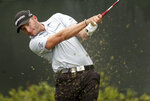 Dean Burmester, of South Africa, drives off the second tee during a practice round for the U.S. Open Golf Championship, Wednesday, June 13, 2018, in Southampton, N.Y. (AP Photo/Julio Cortez)