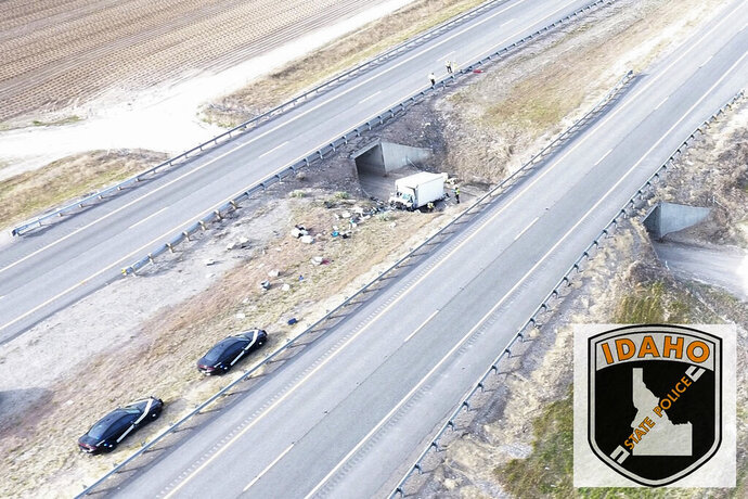 This photo released by the Idaho State Police shows wreckage after a one-vehicle crash on Interstate 15 near the town of Shelley, Idaho, Friday, May 15, 2020. Idaho State Police say two people and more than a dozen dogs died when a box truck transporting animals for a rescue group crashed Friday in eastern Idaho. (Idaho State Police via AP)