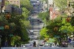 Pedestrians cross Amsterdam Avenue Wednesday, May 20, 2020, in New York. (AP Photo/Frank Franklin II)