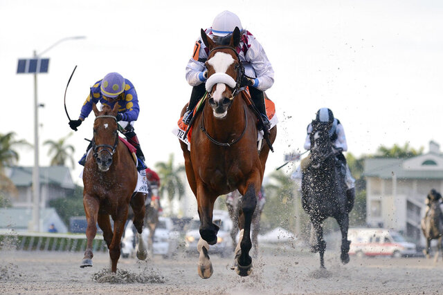 In this March 28, 2020, image provided by Gulfstream Park, Tiz the Law, riddren by Manuel Franco, foreground, runs in the Florida Derby horse race at Gulfstream Park in Hallandale Beach, Fla. Tiz the Law looks every bit like the best 3-year-old in the world and is the Triple Crown favorite, so it'll take something spectacular from a watered-down field to prevent him from becoming the first New York-bred horse to win the Belmont in over 130 years and take a powerful stride toward the Kentucky Derby. (Ryan Thompson/Coglianese Photos, Gulfstream Park via AP)