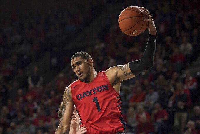 Dayton forward Obi Toppin (1) pulls down a one handed rebound against Richmond during the first half of an NCAA college basketball game in Richmond, Va., Saturday, Jan. 25, 2020.(AP Photo/Lee Luther Jr.)