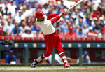 Cincinnati Reds' Eugenio Suarez hits a three-run home run off Chicago Cubs starting pitcher Jon Lester during the first inning of a baseball game, Sunday, June 30, 2019, in Cincinnati. (AP Photo/Gary Landers)