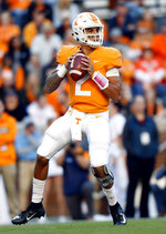 Tennessee quarterback Jarrett Guarantano (2) looks for a receiver in the first half of an NCAA college football game against Missouri Saturday, Nov. 17, 2018, in Knoxville, Tenn. (AP Photo/Wade Payne)