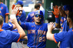 New York Mets' Javier Baez celebrates his home run in the dugout during the third inning of a baseball game against the Washington Nationals, Sunday, Sept. 5, 2021, in Washington. (AP Photo/Nick Wass)