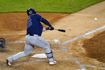 Tampa Bay Rays' Ji-Man Choi (26) hits an RBI-single during the sixth inning of a baseball game against the New York Yankees, Monday, Aug. 31, 2020, at Yankee Stadium in New York. (AP Photo/Kathy Willens)