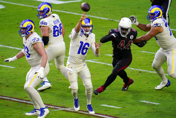 Los Angeles Rams quarterback Jared Goff (16) throws as Arizona Cardinals Markus Golden (44) pursues during the first half of an NFL football game, Sunday, Dec. 6, 2020, in Glendale, Ariz. (AP Photo/Ross D. Franklin)