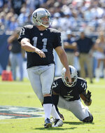 FILE - In this Sept. 25, 2016, file photo, Oakland Raiders kicker Sebastian Janikowski (11) watches his 52-yard field goal against the Tennessee Titans in the first half of an NFL football game, in Nashville, Tenn. Holding is Marquette King (7). Former Oakland Raiders kicker Sebastian Janikowski is set to retire after an 18-year career. Janikowski spent 17 of his seasons with Oakland before kicking last season with the Seattle Seahawks after signing a one-year deal. Janikowski's agent, Paul Healy, confirmed to The Associated Press on Monday, April 29, 2019, his client intends to retire. Janikowksi, 41, told ESPN over the weekend he didn't believe his body could handle kicking in the NFL anymore. (AP Photo/Mark Zaleski, File)