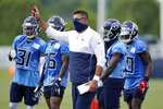 Tennessee Titans head coach Mike Vrabel, center, leads a drill during NFL football training camp Sunday, Aug. 16, 2020, in Nashville, Tenn. (AP Photo/Mark Humphrey)