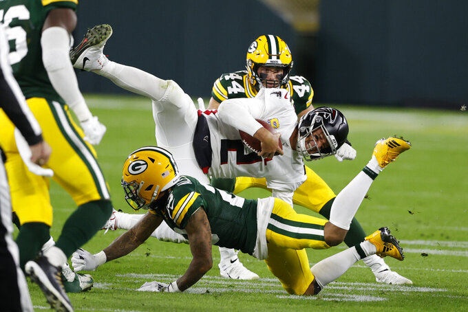 Atlanta Falcons quarterback Matt Ryan (2) is tackled by Green Bay Packers' Jaire Alexander (23) during the second half of an NFL football game, Monday, Oct. 5, 2020, in Green Bay, Wis. (AP Photo/Tom Lynn)