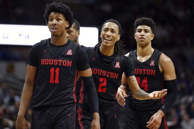 Houston's Caleb Mills (2) reacts toward an official as Houston's Nate Hinton (11) and Houston's Quentin Grimes (24) look on in the second half of an NCAA college basketball game against Connecticut, Thursday, March 5, 2020, in Storrs, Conn. (AP Photo/Jessica Hill)