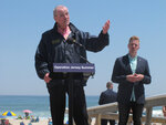 New Jersey Gov. Phil Murphy, left, speaks at a news conference at Island Beach State Park in New Jersey on Wednesday, May 19, 2021, where he announced that the state will give free season-long admission to the park and other state parks to any New Jersey resident who has gotten at least one dose of COVID-19 vaccine by July 4. Other incentives to get people to take the shot include a free glass of wine at participating wineries. At right is Shawn LaTourette, the acting environmental protection commissioner. (AP Photo/Wayne Parry)