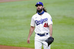 Los Angeles Dodgers starting pitcher Tony Gonsolin walks to the dugout after the top of the third inning against the Atlanta Braves in Game 2 of a baseball National League Championship Series Tuesday, Oct. 13, 2020, in Arlington, Texas. (AP Photo/Eric Gay)