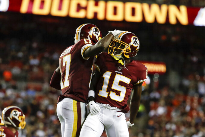 Washington Redskins wide receiver Terry McLaurin (17) celebrates his touchdown with wide receiver Steven Sims (15) during the second half of an NFL football game against the Chicago Bears, Monday, Sept. 23, 2019, in Landover, Md. (AP Photo/Julio Cortez)