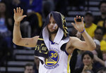 Golden State Warriors' Stephen Curry celebrates a teammate's score during the second half of Game 1 of the NBA basketball playoffs Western Conference finals against the Portland Trail Blazers on Tuesday, May 14, 2019, in Oakland, Calif. (AP Photo/Ben Margot)