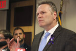 FILE - In this March 12, 2020 file photon Alaska Gov. Mike Dunleavy speaks during a news conference in Anchorage, Alaska. Dunleavy has announced that checks from the state's oil-wealth fund will begin going out to residents three months early, citing economic hardships related to the coronavirus. (AP Photo/Mark Thiessen,File)
