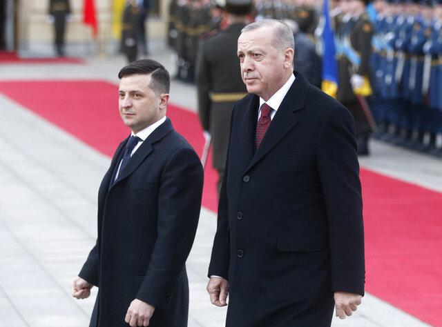 Ukrainian President Volodymyr Zelenskiy, left, and Turkey's President Recep Tayyip Erdogan review the honor guard during a welcome ceremony ahead of their talks in Kyiv, Ukraine, Monday, Feb. 3, 2020. (AP Photo/Efrem Lukatsky)
