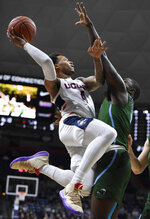 Connecticut's Jalen Adams (4) goes up to the basket as Tulane's Jordan Cornish defends during the first half of an NCAA college basketball game, Saturday, Jan. 19, 2019, in Storrs, Conn. (AP Photo/Jessica Hill)