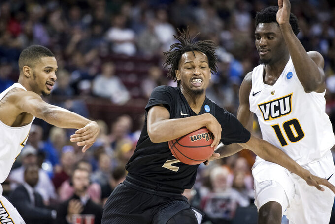 Central Florida guard Terrell Allen (2) drives to the hoop against VCU guard Vince Williams (10) during the first half of a first-round game in the NCAA men's college basketball tournament Friday, March 22, 2019, in Columbia, S.C. (AP Photo/Sean Rayford)