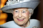 FILE - In this Feb. 20, 2018 file photo, Britain's Queen Elizabeth II smiles during a visit to the  Royal College of Physicians, in London. Queen Elizabeth II is marking her 92nd birthday with a concert in London featuring British singers such as Sting, Tom Jones and Jamie Cullum on Saturday, April 21, 2018. (Chris Jackson/PA via AP, File)