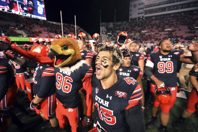 Utah wide receiver Samson Nacua (45) celebrates with teammate in the second half, following their NCAA college football game against Oregon Saturday Nov. 10, 2018, in Salt Lake City. (AP Photo/Rick Bowmer)