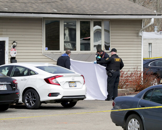 Officials investigate the scene of an early Sunday fatal shooting at Somers House Tavern in Kenosha, Wis., on Sunday, April 18 2021. (Mike De Sisti/Milwaukee Journal-Sentinel via AP)
