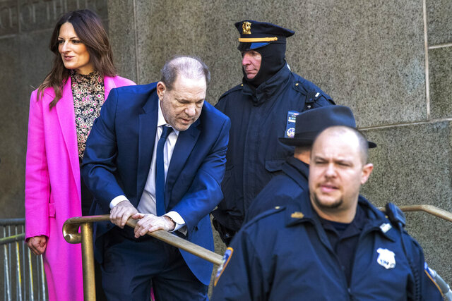 Harvey Weinstein, center, leaves Manhattan criminal court with his lead attorney Donna Rotunno, left, after jury selection during his sexual assault trial, Thursday, Jan. 9, 2020, in New York. (AP Photo/Mary Altaffer)