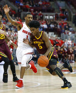Minnesota's Marcus Carr, right, drives to the basket against Ohio State's Luther Muhammad during the first half of an NCAA college basketball game Thursday, Jan. 23, 2020, in Columbus, Ohio. (AP Photo/Jay LaPrete)
