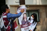 Supporters of the ruling party Morena mayoral candidate Paula Soto, place a poster on an electrical pole on the last day of campaigning leading up to the June 6 mid-term elections, in Mexico City, Saturday, May 29, 2021. (AP Photo/Ginnette Riquelme)