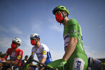 Sam Bennett of Ireland, wearing the best sprinter's green jersey, wears a face mask reading