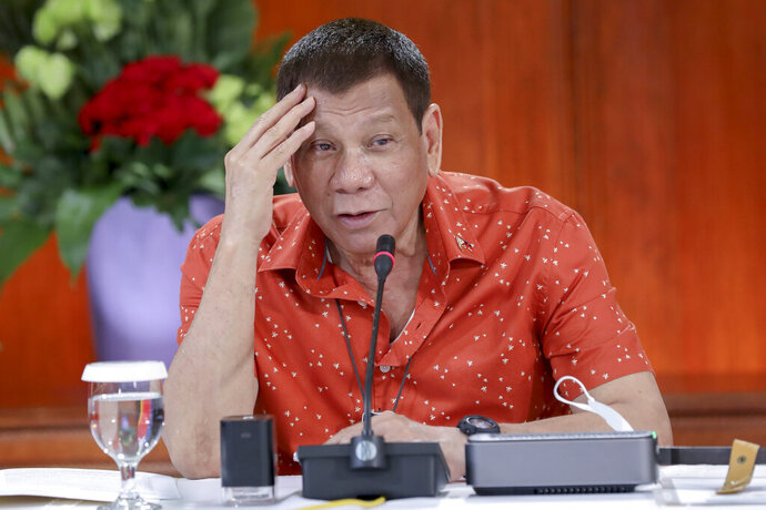 In this photo provided by the Malacanang Presidential Photographers Division, Philippine President Rodrigo Duterte attends a meeting at the Malacanang presidential palace in Manila, Philippines on Monday Oct. 19, 2020. The Philippine president has said he could be held responsible for the thousands of killings under his anti-drugs crackdown and was ready to face charges, except crimes against humanity, that could land him in jail. (Robinson Ninal Jr./Malacanang Presidential Photographers Division via AP)