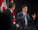 Prime Minister Justin Trudeau, Liberal Party, of Canada Leader, speaks to supporters as Marc Miller, MP of Ville-Marie-Le Sud-Ouest-Ile-des-Soeurs, looks on during an armchair discussion at an open Liberal Party fundraising event in Montreal, Quebec, Monday, June 17, 2019. (Peter McCabe/The Canadian Press via AP)