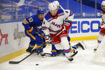 New York Rangers defenseman Jacob Trouba (8) carries the puck during the second period of an NHL hockey game against the Buffalo Sabres, Tuesday, Jan. 26, 2021, in Buffalo, N.Y. (AP Photo/Jeffrey T. Barnes)