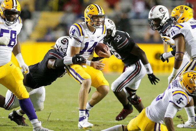 LSU quarterback Max Johnson (14) runs the ball against South Carolina during the second half of an NCAA college football game in Baton Rouge, La., Saturday, Oct. 24, 2020. (AP Photo/Brett Duke)