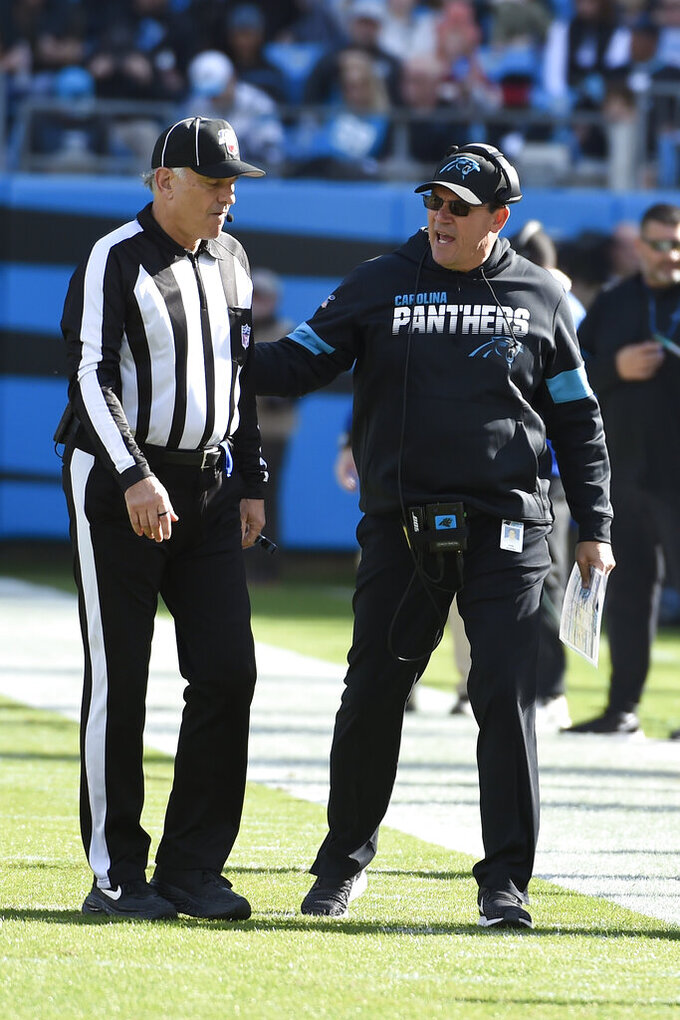 Carolina Panthers head coach Ron Rivera speaks with an official during the first half of an NFL football game against the Washington Redskins in Charlotte, N.C., Sunday, Dec. 1, 2019. (AP Photo/Mike McCarn)